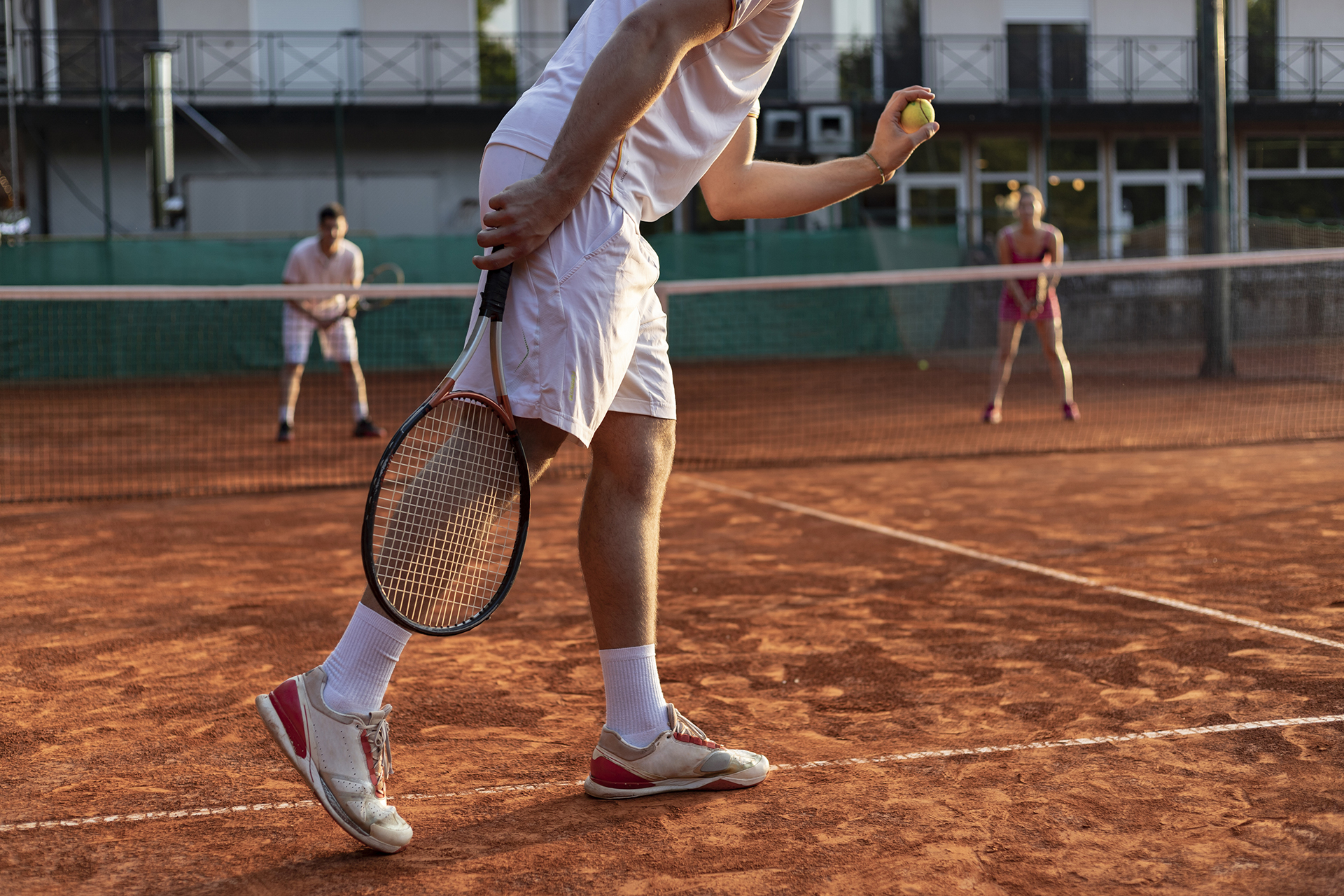 tennis player serving outdoor